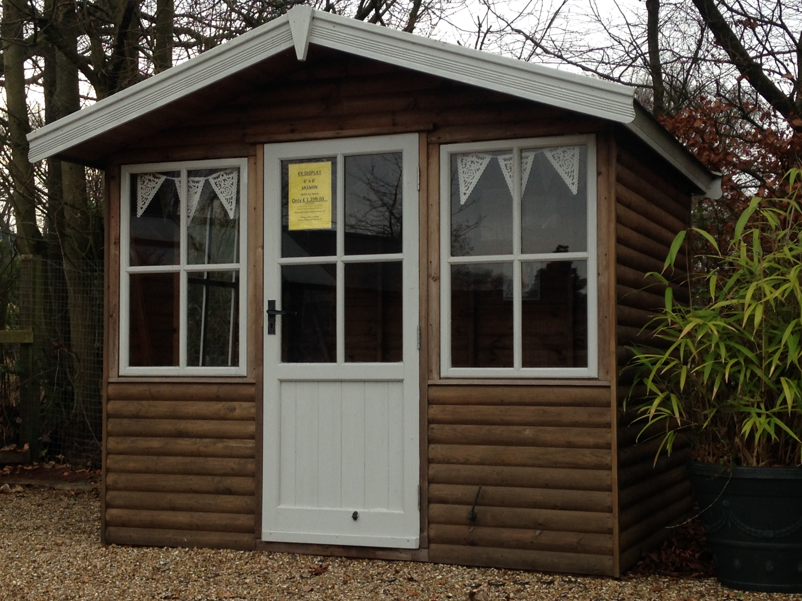 "<p id=""boldtitle"">Ex Display</p>6' x 8' Jasmin In loglap cladding and felt tiled roof<br/>£ 1299.00 inc vat."