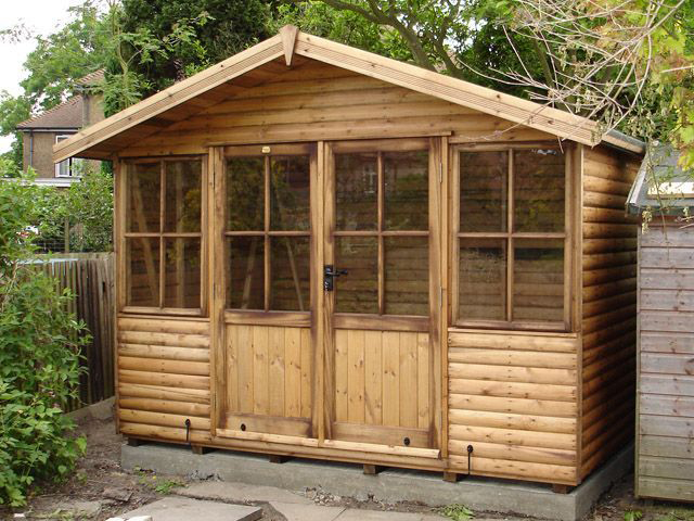 "<p id=""boldtitle"">Jasmin Chalet</p> 8' x 10' (2440mm x 3050mm) Jasmin chalet with optional loglap cladding and double doors.<br/>"