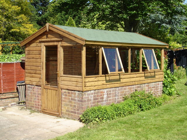 "<p id=""boldtitle"">Gable Potting Shed</p>12' x 7' (3660mm x 2135mm) gable potting shed in T&G shiplap.  <br/>Fitted onto existing dwarf wall, with optional half glazed door, additional windows at back, green felt tiles<br/>and profiled fascias.<br/>"