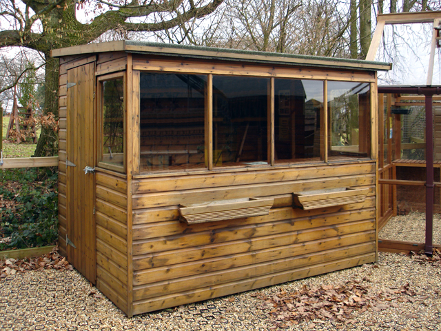 "<p id=""boldtitle"">Pent Potting Shed</p>8' x 6' (2440mm x 1830mm) pent potting shed in T&G shiplap.  <br/>Showing optional window boxes."