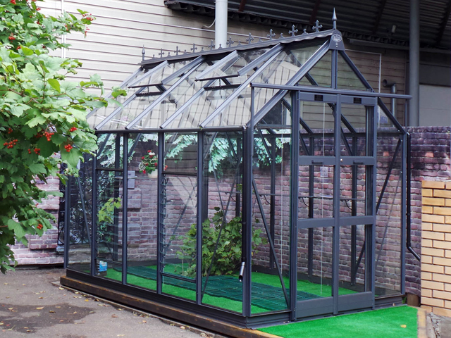 "<p id=""boldtitle"">Elite Greenhouses</p>10 x 6 Titan.<br/>Graphite.<br/>Crestings & finials."